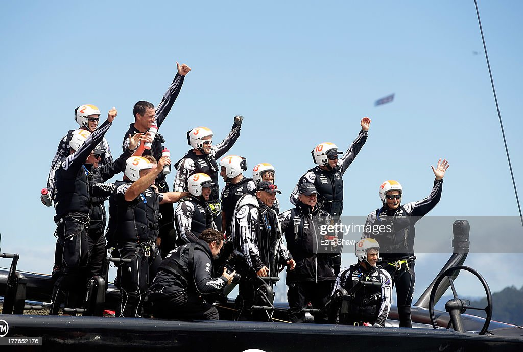 Emirates Team New Zealand skippered by <a gi-track='captionPersonalityLinkClicked' href=/galleries/search?phrase=Dean+Barker&family=editorial&specificpeople=636929 ng-click='$event.stopPropagation()'>Dean Barker</a> (right) celebrates after they beat Team Luna Rossa Challenge in race eight to win the Louis Vuitton Cup finals on August 25, 2013 in San Francisco, California. Emirates Team New Zealand won the Louis Vuitton Cup 7-1 and will now race against Oracle Team USA in the America's Cup Finals that start on September 7.