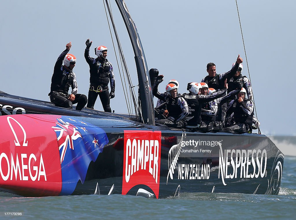 Emirates Team New Zealand skippered by Dean Barker celebrates thier victory over Team Luna Rossa Challenge skippered by Massimiliano Sirena during race five of the Louis Vuitton Cup finals on August 21, 2013 in San Francisco, California.