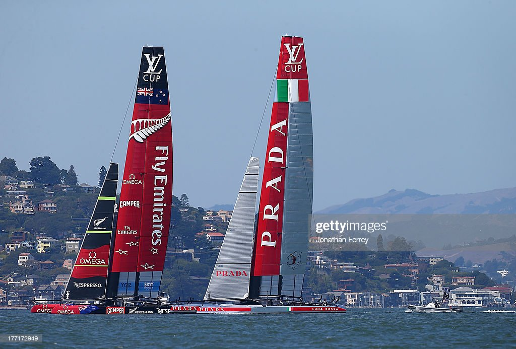Emirates Team New Zealand skippered by Dean Barker (L) in action against Team Luna Rossa Challenge skippered by Massimiliano Sirena (R) during race four of the Louis Vuitton Cup finals on August 21, 2013 in San Francisco, California.
