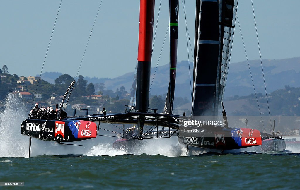 Emirates Team New Zealand skippered by Dean Barker in action against Oracle Team USA skippered by James Spithill at the start of race 12 of the America's Cup Finals on September 18, 2013 in San Francisco, California. The race was postponed right before the race began but both teams still raced to the first mark.