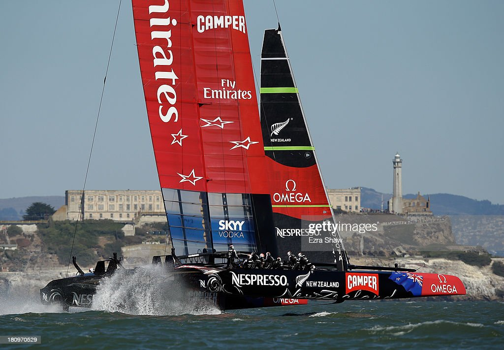 Emirates Team New Zealand skippered by Dean Barker in action against Oracle Team USA skippered by James Spithill during race 12 of the America's Cup Finals on September 18, 2013 in San Francisco, California. The race was postponed right before the race began but both teams still raced to the first mark.