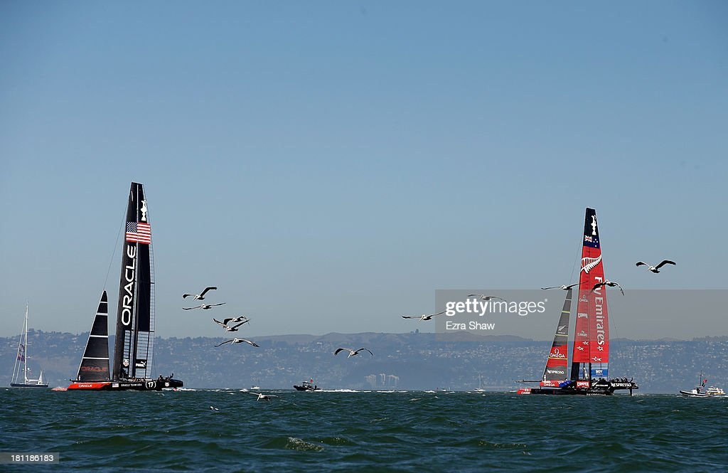 Emirates Team New Zealand skippered by Dean Barker in action against Oracle Team USA skippered by James Spithill during race 12 of the America's Cup...