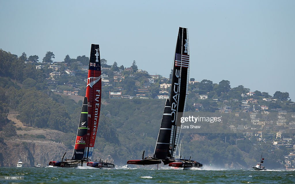 Emirates Team New Zealand skippered by Dean Barker in action against Oracle Team USA skippered by James Spithill during race 12 of the America's Cup Finals on September 19, 2013 in San Francisco, California. Oracle Team USA won the race.