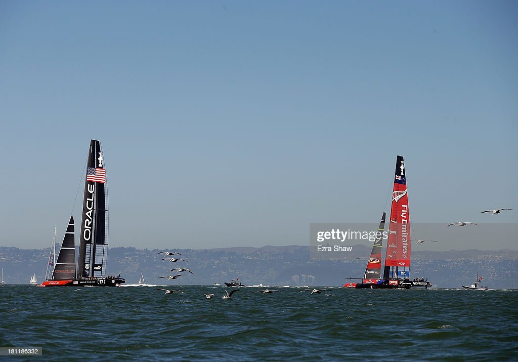 Emirates Team New Zealand (R) skippered by Dean Barker in action against Oracle Team USA skippered by James Spithill during race 12 of the America's Cup Finals on September 19, 2013 in San Francisco, California.