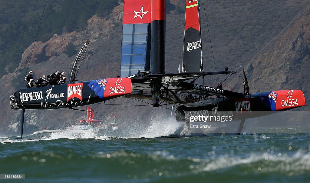 Emirates Team New Zealand skippered by Dean Barker in action against Oracle Team USA skippered by James Spithill during race 12 of the America's Cup Finals on September 19, 2013 in San Francisco, California.