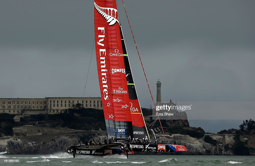 Emirates Team New Zealand skippered by Dean Barker in action against Oracle Team USA skippered by James Spithill during race 13 of the America's Cup Finals on September 20, 2013 in San Francisco, California. Race 13 was initially abandoned due to the race exceeding the time limit. Oracle Team USA won the restart of race 13.