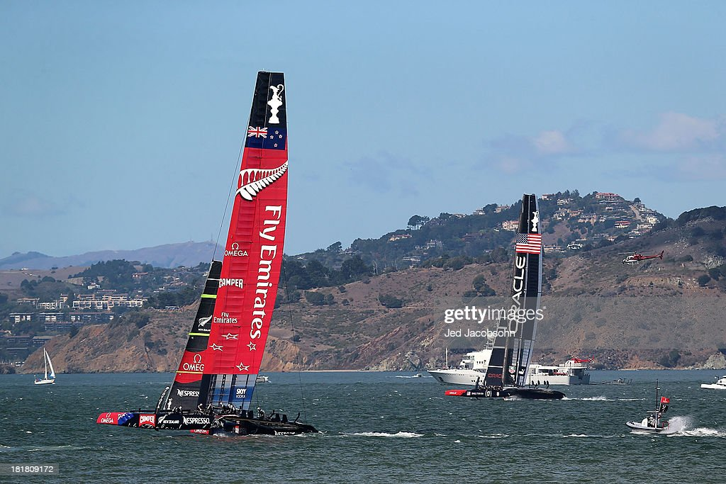 Emirates Team New Zealand skippered by Dean Barker in action against Oracle Team USA skippered by James Spithill during the final race of the America's Cup Finals on September 25, 2013 in San Francisco, California.