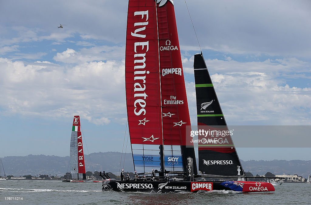 Emirates Team New Zealand (R) skippered by Dean Barker passes by Team Luna Rossa Challenge (L) skippered by Massimiliano Sirena after their catamaran broke during race one of the Louis Vuitton Cup finals on August 17, 2013 in San Francisco, California. The winner of the Louis Vuitton Cup goes on to race against Oracle Team USA in the America's Cup Finals that start on September 7. Emirates Team New Zealand won race one.