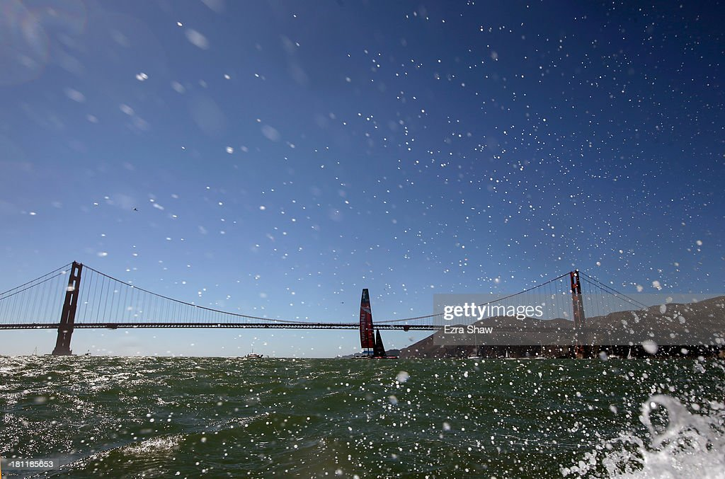 Emirates Team New Zealand skippered by Dean Barker sails by the Golden Gate Bridge after race 12 against Oracle Team USA in the America's Cup Finals on September 19, 2013 in San Francisco, California. Oracle Team USA won race 12 and race 13 was postponed due to high winds.