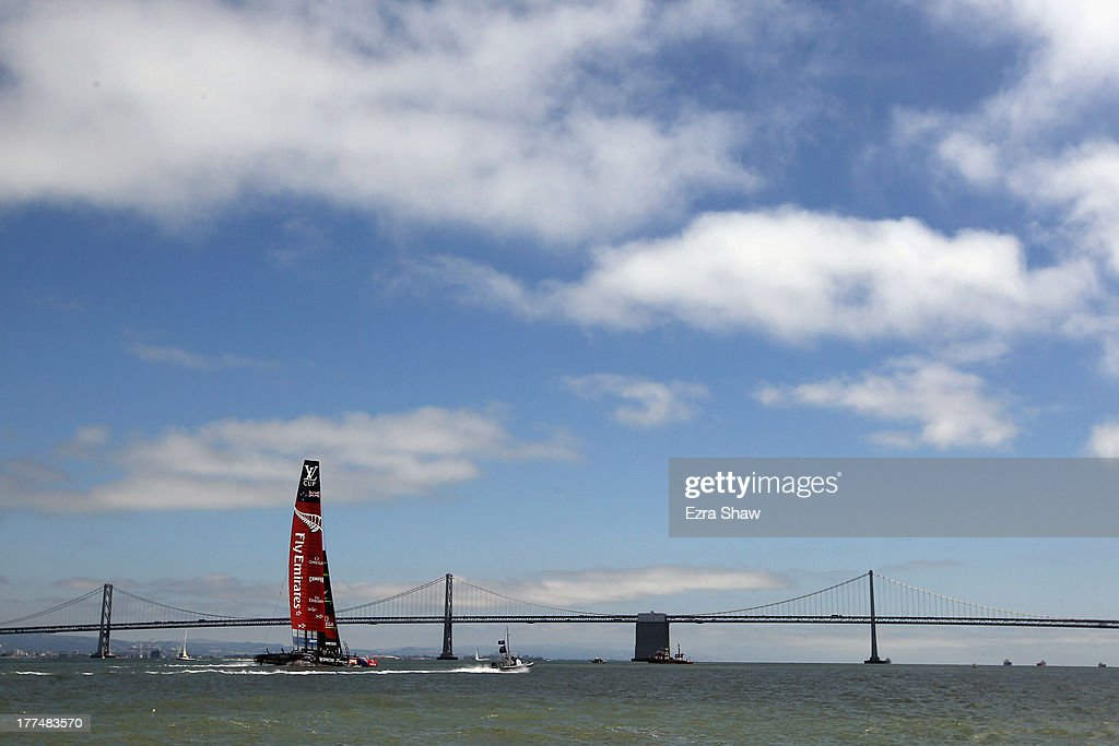 Emirates Team New Zealand skippered by Dean Barker sails near the San Francisco-Oakland Bay Bridge following race six of the Louis Vuitton Cup finals against Team Luna Rossa Challenge skippered by Massimiliano Sirena with Chris Draper on the helm on August 23, 2013 in San Francisco, California. Emirates Team New Zealand won the race to take a 5-1 lead in the series. The winner of the Louis Vuitton Cup goes on to race against Oracle Team USA in the America's Cup Finals that start on September 7.