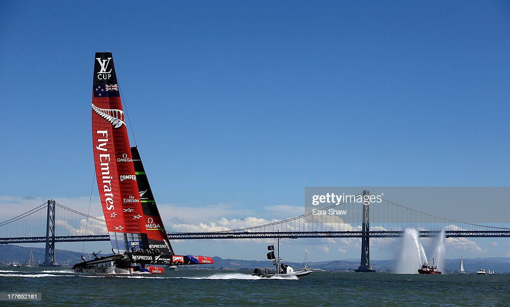 Emirates Team New Zealand skippered by <a gi-track='captionPersonalityLinkClicked' href=/galleries/search?phrase=Dean+Barker&family=editorial&specificpeople=636929 ng-click='$event.stopPropagation()'>Dean Barker</a> sails near the San Francisco-Oakland Bay Bridge after they beat Team Luna Rossa Challenge in race eight to win the Louis Vuitton Cup finals on August 25, 2013 in San Francisco, California. Emirates Team New Zealand won the Louis Vuitton Cup 7-1 and will now race against Oracle Team USA in the America's Cup Finals that start on September 7.