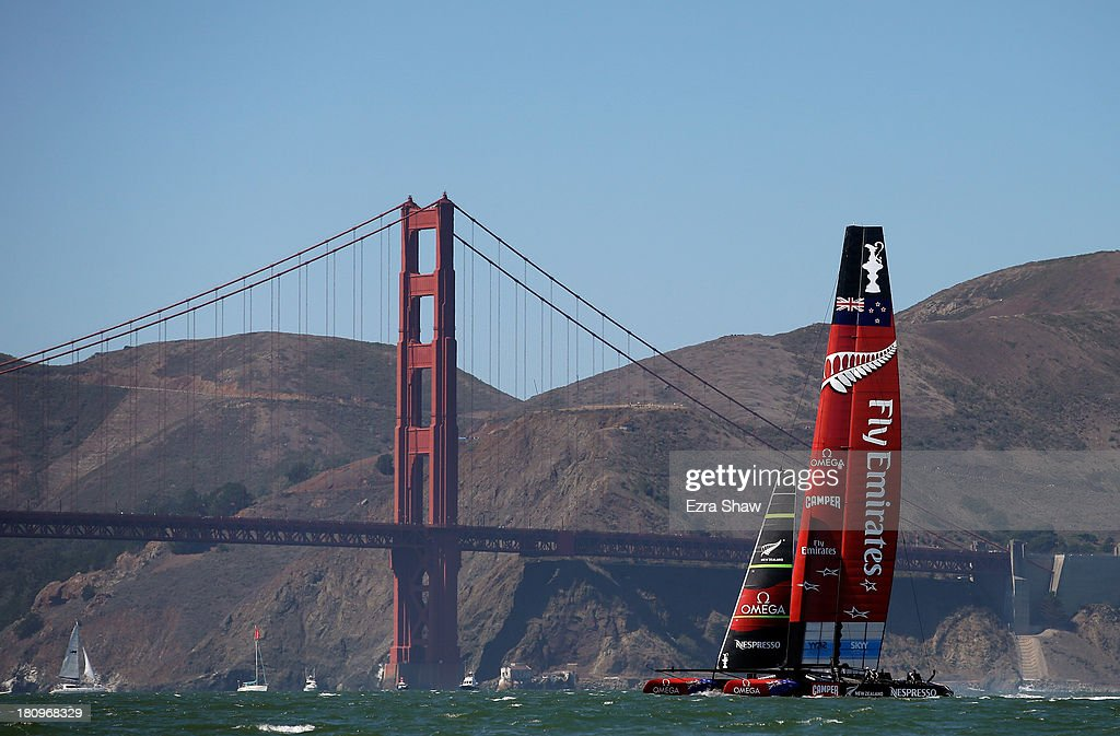 Emirates Team New Zealand skippered by Dean Barker warms up near the Golden Gate Bridge before racing against Oracle Team USA skippered by James Spithill in race 11 of the America's Cup Finals on September 18, 2013 in San Francisco, California.