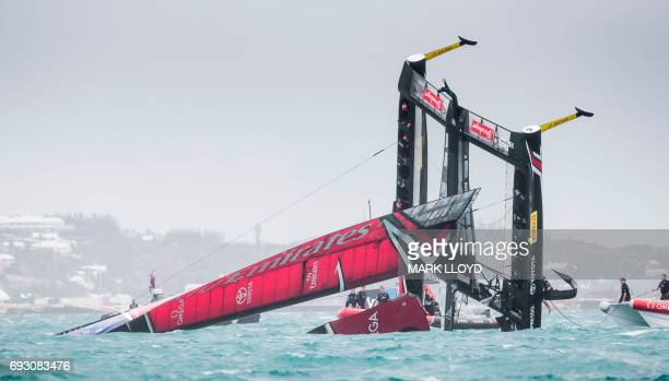 TOPSHOT Emirates Team New Zealand skippered by Peter Burling is seen capsizing at the race start in race 5 of the 35th America's Cup Challenger...