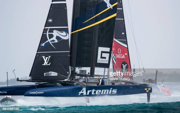 Emirates Team New Zealand skippered by Peter Burling races against Artemis Racing skippered by Nathan Outteridge during the 35th America's Cup Louis...