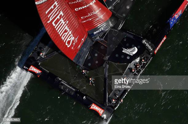 Emirates Team New Zealand skippered Dean Barker in action against Oracle Team USA skippered James Spithill during race two of the America's Cup...