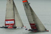 Emirates Team New Zealand tacks ahead of the Synergy Russian Sailing Team during the Louis Vuitton Trophy held on the Waitemata Harbour on March 16...