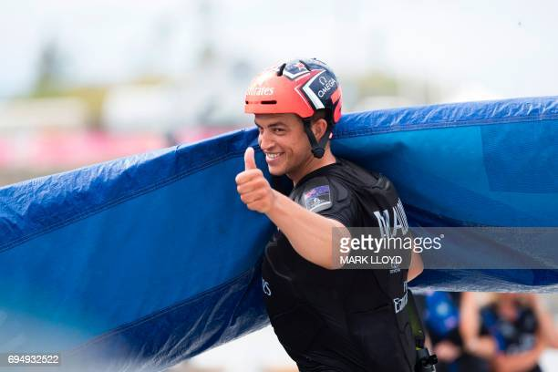 Emirates Team New Zealand trimer Andy Maloney celebrates after going 43 up in the 35th America's Cup Louis Vuitton Challenger Playoffs finals in...