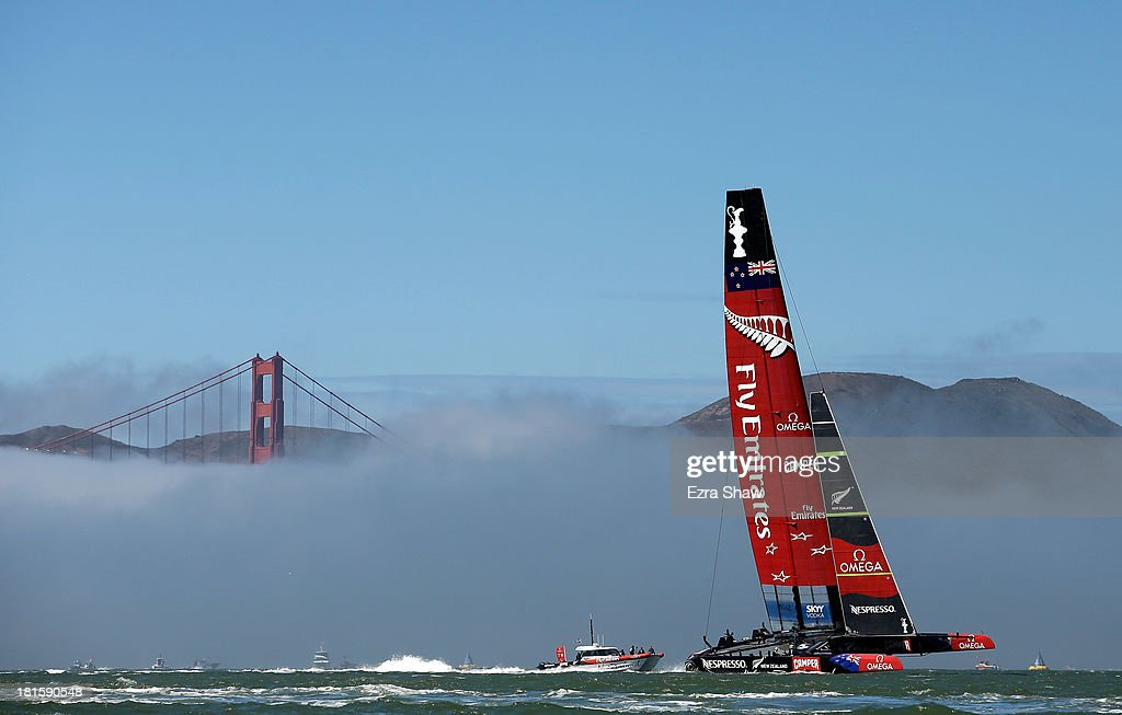 Emirates Team New Zealand warms up near the Golden Gate Bridge before racing against Oracle Team USA in race 14 of the America's Cup Finals on September 22, 2013 in San Francisco, California. Oracle Team USA won both race 14 and 15 today.