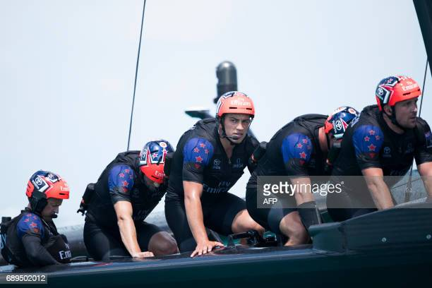 Emirates Team New Zealand work their pedal powered race yacht on the second day of the America's Cup on May 28 2017 on Bermuda's Great Sound / AFP...
