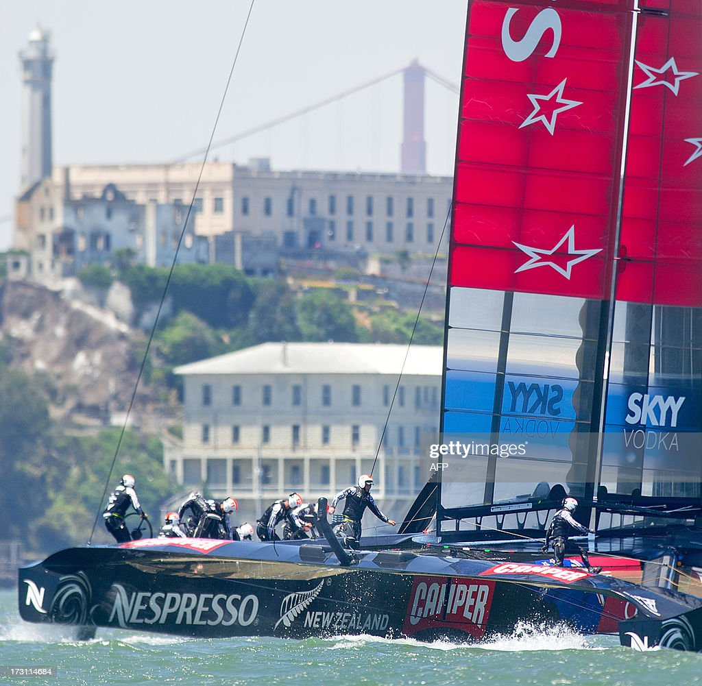 Emirates Team New Zealand's AC72 catamaran sails past Alcatraz Island during the first round robin of the Louis Vuitton Cup on Sunday, July 7, 2013 in San Francisco. Luna Rossa Challenge, originally slated to compete, chose to sit out the race while awaiting a jury decision on a protest motion.
