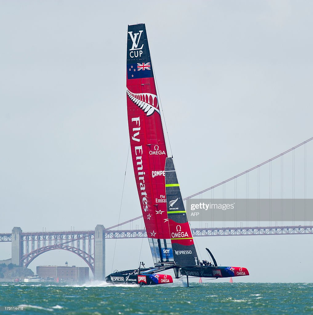 Emirates Team New Zealand's AC72 catamaran sails past the Golden Gate Bridge during the first round robin of the Louis Vuitton Cup on July 7, 2013, in San Francisco. Luna Rossa Challenge, originally slated to compete Sunday, chose to sit out the race while awaiting a jury decision on a protest motion. AFP PHOTO/NOAH BERGER