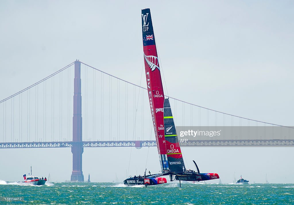 Emirates Team New Zealand's AC72 catamaran sails past the Golden Gate Bridge during the first round robin of the Louis Vuitton Cup on July 7, 2013, in San Francisco. Luna Rossa Challenge, originally slated to compete Sunday, chose to sit out the race while awaiting a jury decision on a protest motion.