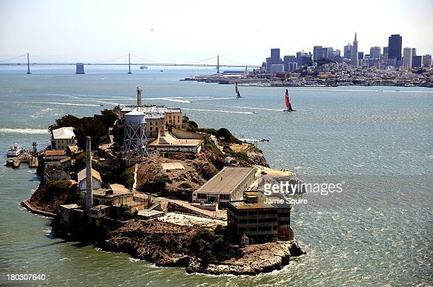 Emirates Team Zew Zealand races ahead of Oracle Team USA as they pass in front of Alcatraz Island and the San Francisco skyline during race 5 of the...