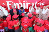 Emirates' Vice President North America Jim Baxter and ATP Tennis Pro Milos Raonic talk with young tennis players at the Emirates USTA Serves DC Mayor...