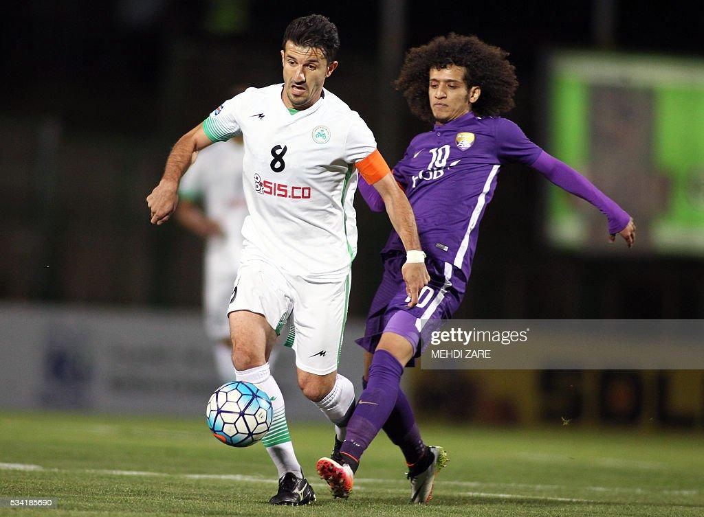 Emirati Al-Ain club's Omar Abdulrahman (R) vies for the ball with Iranian Zobahan club's Ghasem Hadadifar during their Asian Champions League round 16 football match at Foolad Shahr Stadium in Isfahan on May 25, 2016. / AFP / MEHDI