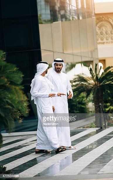 Emirati business outdoors meeting
