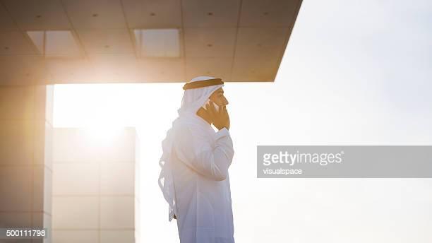 Emirati Businessman On A Rooftop In Evening Sunlight