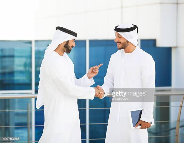 Emirati Businessmen Meeting Outside Office