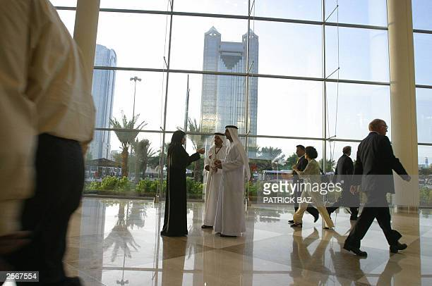 Emirati citizens chat in the lobby of the International Convention Center in Dubai 23 September 2003 AFP PHOTO/atrick BAZ