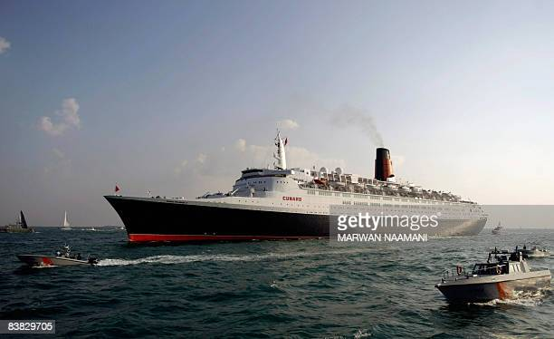 Emirati coast guards escort the famous cruise liner Queen Elizabeth 2 to its final destination upon its arrival at Dubai on November 26 2008 The...