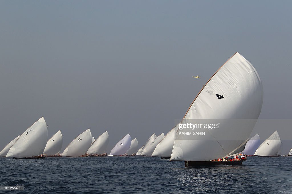 Emirati competitors sail in the Gulf during the Al-Gaffal 60 ft traditional dhow sailing race between the island of Sir Bu Nair, near the Iranian coast, and the Gulf emirate of Dubai on May 29, 2010.