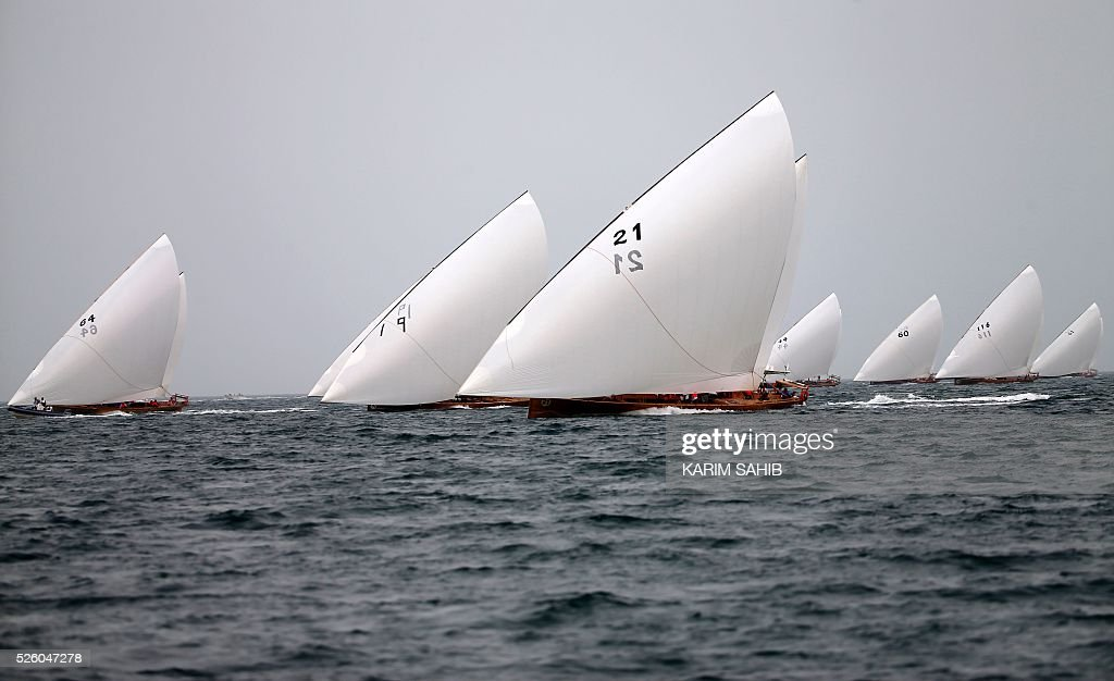 Emirati competitors sail on traditional dhows during the 'Jenana Dhow Sailing' race as part of the al-Gharbia Watersports festival on April 29, 2016 off the coast of al-Mirfa beach, outside Abu Dhabi, in the UAE Emirate. The festival runs until May 2. / AFP / KARIM