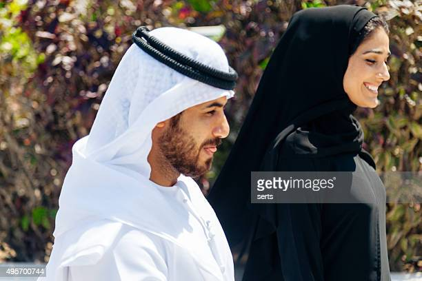 Emirati couple walking in the park