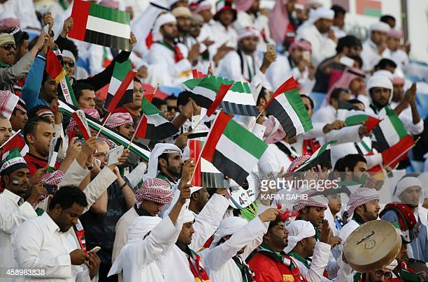 Emirati fans cheer for their team prior to the start of the Gulf Cup of Nations Group B football match between United Arab Emirates and Oman on...