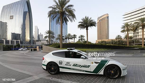 Emirati female police officers drive a Ferrari police vehicle in the Gulf emirate of Dubai on April 25 2013 Dubai police showed off a new Ferrari...