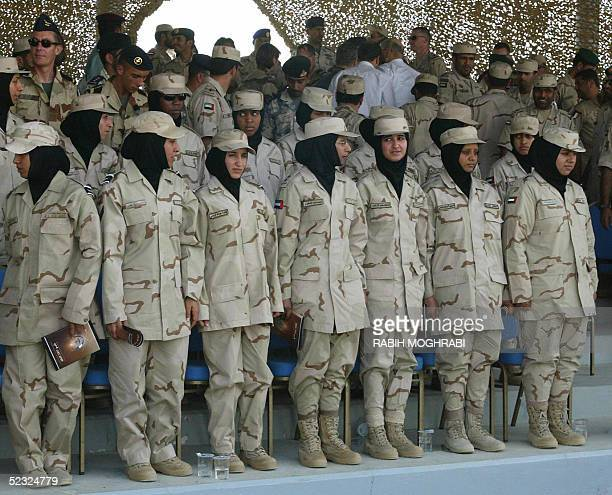 Emirati female soldiers watch joint EmiratiFrench maneuvers in the desert outside the United Arab Emirates's capital Abu Dhabi 09 March 2005 AFP...