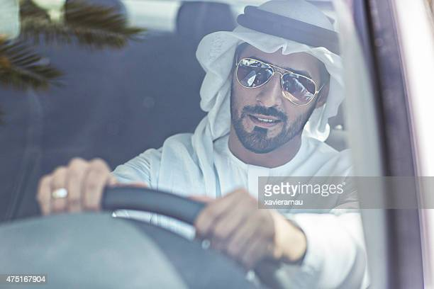 Emirati man driving his car