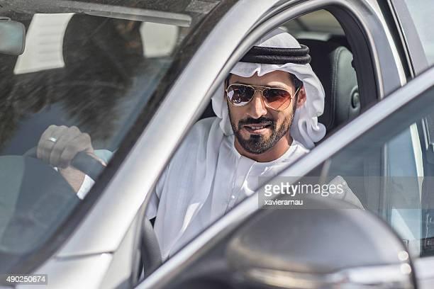 Emirati man getting on his car