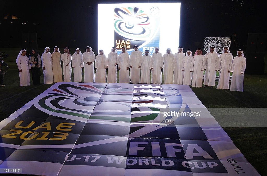 Emirati officials member of the organizing committee stand next to the official emblem of the FIFA U17 World Cup during an unveiling ceremony at the Emirates Palace in Abu Dhabi, on March 5, 2013. The 2013 U-17 World Cup will be held in the United Arab Emirates between October 17 and November 8.
