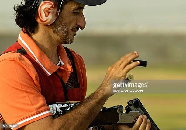 Emirati Olympic shooting gold medalist Sheikh Ahmed bin Hasher alMaktoum a member of Dubai's ruling family ejects spent cartridges from his shotgun...
