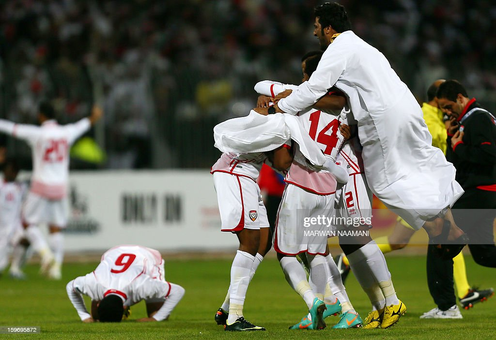 Emirati players celebrate after winning the final of the 21st Gulf Cup on January 18, 2013 in Manama. United Arab Emirates won 2-1 against Iraq.