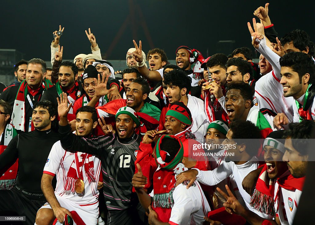 Emirati players pose with their medals after winning the final of the 21st Gulf Cup on January 18, 2013 in Manama. United Arab Emirates won 2-1 against Iraq. AFP PHOTO/MARWAN NAAMANI