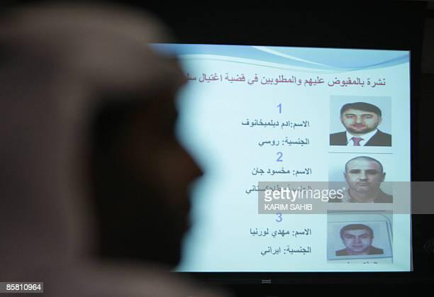 Emirati police display the portraits of Chechen Vice Prime Minister Adam Delimkhanov Tajik national Makhsud Jan and Iranian citizen Mahdi Lournia...