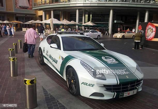 Emirati policemen patrol in a Ferrari in the Gulf emirate of Dubai on April 22 2013 The sleek Ferrari has joined the $550000 Lamborghini Aventador...