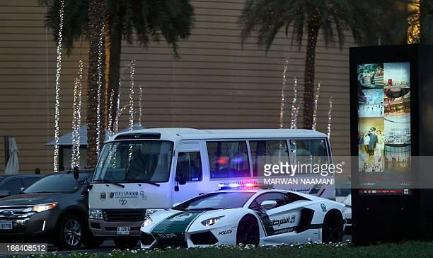 Emirati policemen patrol in a Lamborghini Aventador near Burj Khalifa in the Gulf emirate of Dubai on April 12 2013 A sleek $550000 Lamborghini...