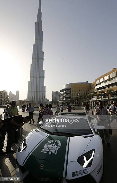 Emirati policemen patrol in an especially modified Lamborghini Aventador on April 16 2013 in the Gulf emirate of Dubai The introduction of the sports...
